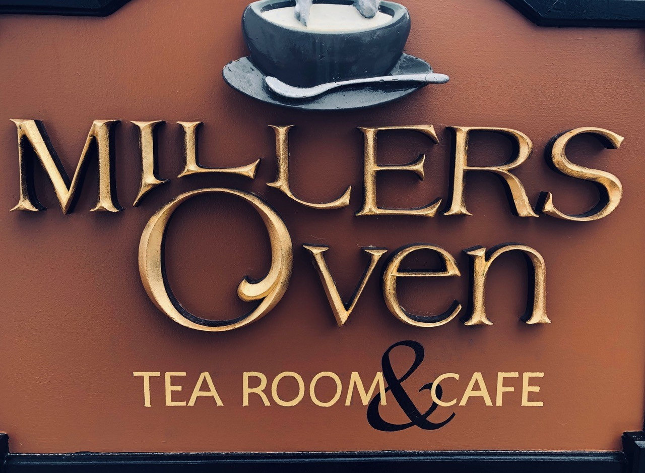 Miller's Oven Cafe & Tea Room logo